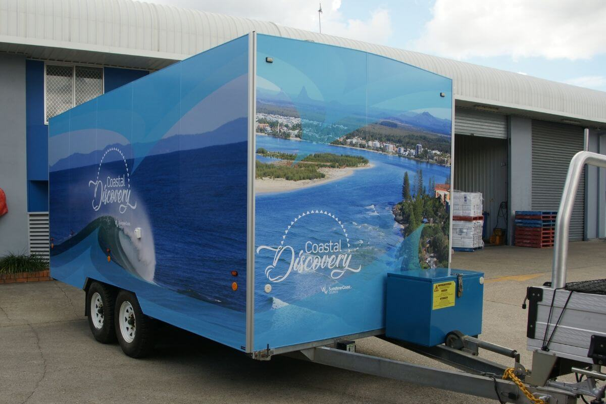 right side external graphics coastal discovery van