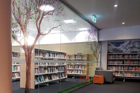 vinyl graphics jacaranda trees and clouds toowong children's library